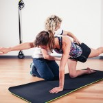 Therapist correcting woman in fitness class