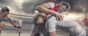 Close Up of Rugby Player Tackled Hard During Match